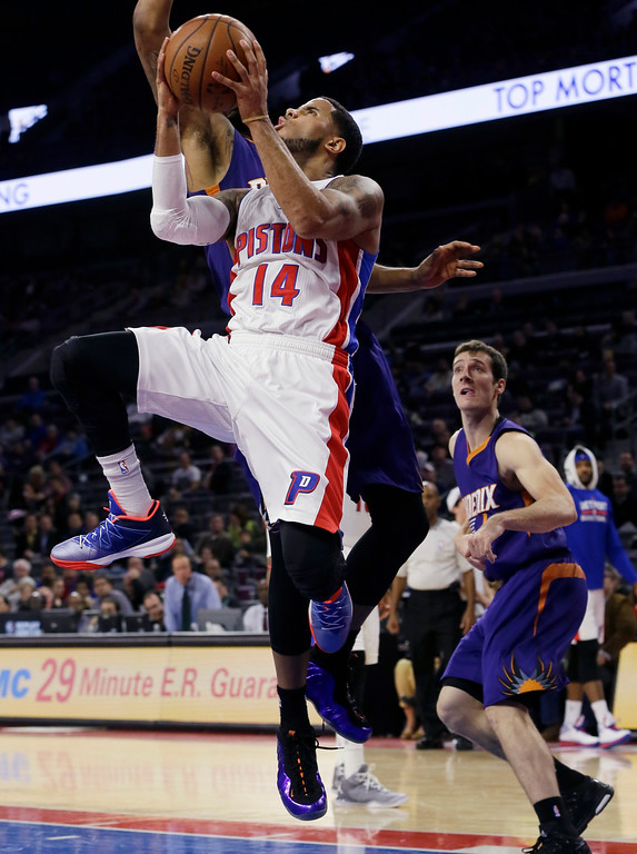 . Detroit Pistons guard D.J. Augustin (14) makes a layup during the first half of an NBA basketball game against the Phoenix Suns in Auburn Hills, Mich., Wednesday, Nov. 19, 2014. (AP Photo/Carlos Osorio)