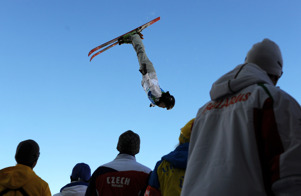 . Zhibek Arapbayeva of Kazakhstan goes airborne while the coaches look on during the Women\'s Freestyle Skiing Aerials qualification at Cypress Mountain, north of Vancouver, during the Vancouver Winter Olympics, on February 20, 2010. (ADRIAN DENNIS/AFP/Getty Images)