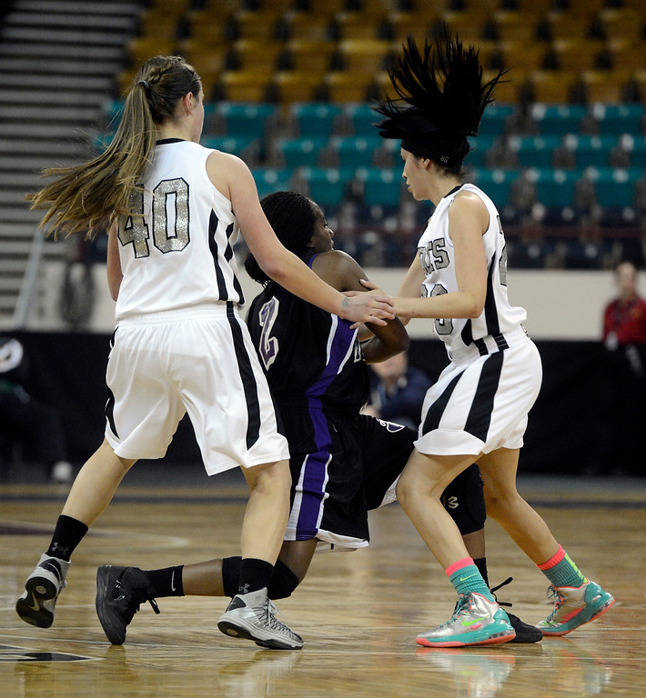 . DENVER, CO. - MARCH 9TH: Gabby Purnell, Mesa Ridge High School, center, gets caught up in between the defense of Kendra Jeslik, left, and Jaylyn Duran, right, Pueblo South High School, in the second half of the 4A �Great Eight� game at the Denver Coliseum, Saturday morning, March 9th, 2013. Pueblo South won 54-33 to advance to the Final Four at the CU Events Center, March 14th, 2013. (Photo By Andy Cross The Denver Post)