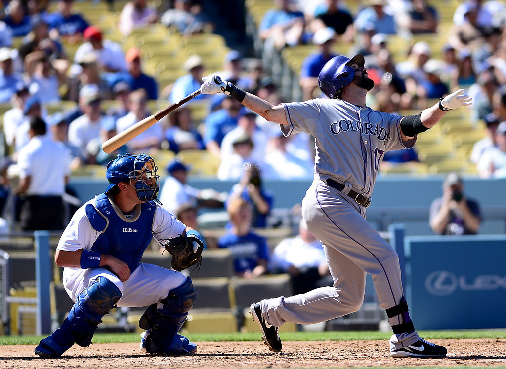 . Rockies\' Todd Helton makes a hit in the first inning as they defeat Dodgers 2-1 at Dodger Stadium during the final game of the regular season Sunday, September 29, 2013. Helton is retiring after 17 seasons. (Photo by Sarah Reingewirtz/Pasadena Star-News)