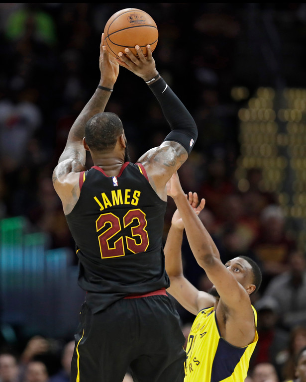 . Cleveland Cavaliers\' LeBron James (23) shoots a game-winning three point shot over Indiana Pacers\' Thaddeus Young (21) in the second half of Game 5 of an NBA basketball first-round playoff series, Wednesday, April 25, 2018, in Cleveland. The Cavaliers won 98-95. (AP Photo/Tony Dejak)