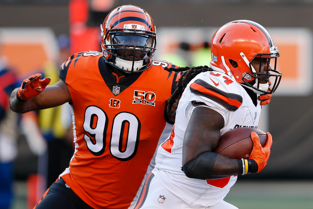 . Cleveland Browns running back Isaiah Crowell (34) runs the ball past Cincinnati Bengals defensive end Michael Johnson (90) in the second half of an NFL football game, Sunday, Nov. 26, 2017, in Cincinnati. (AP Photo/Gary Landers)