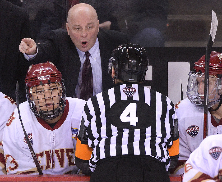 . DENVER, CO. - JANUARY 24:  Denver coach Jim Montgomery made his case with referee Todd Anderson in the third period. The University of North Dakota out hustled the Pioneers to a 4-2 win Friday night, January 24, 2014. Photo By Karl Gehring/The Denver Post