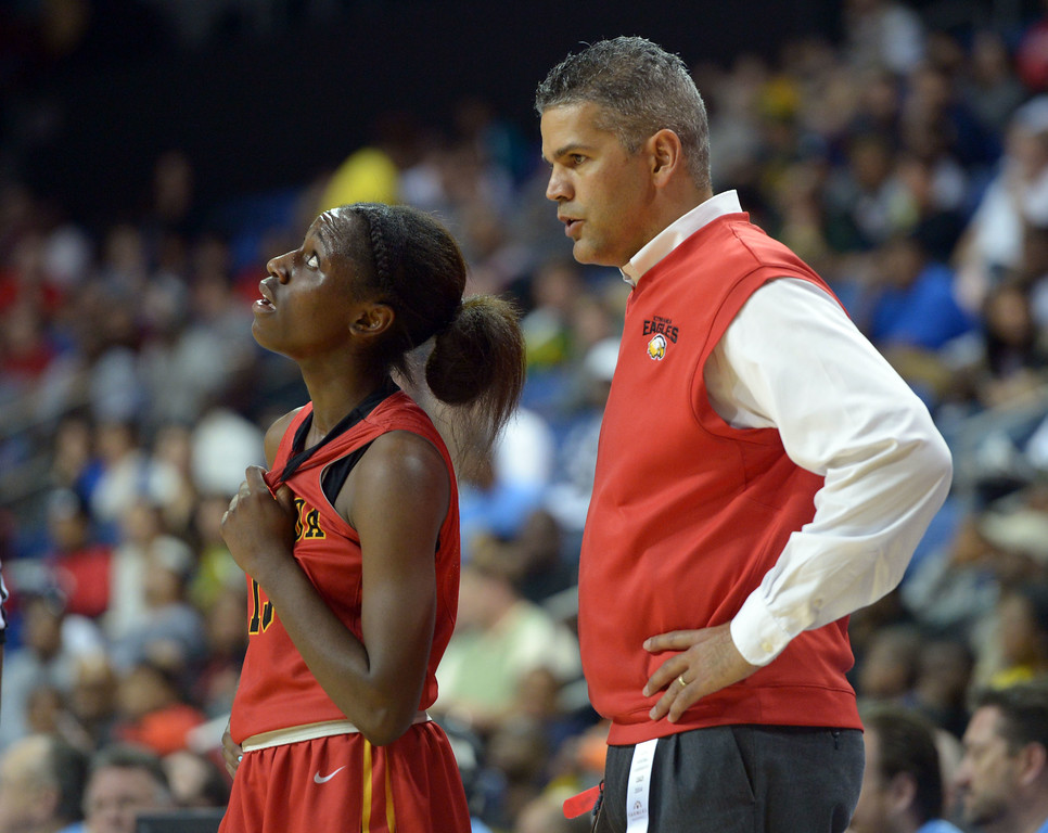 . Etiwanda coach Anders Anderson chats with McKenzie Fort late in the game at Citizens Business Bank Arena in Ontario, CA on Saturday, March 22, 2014. Long Beach Poly vs Etiwanda in the CIF girls open division regional final. 2nd half, Poly won 56-46. Photo by Scott Varley, Daily Breeze)