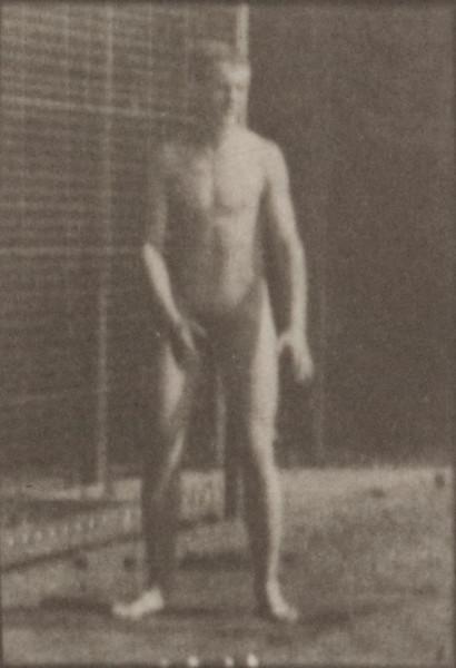 Nude man playing football, punt