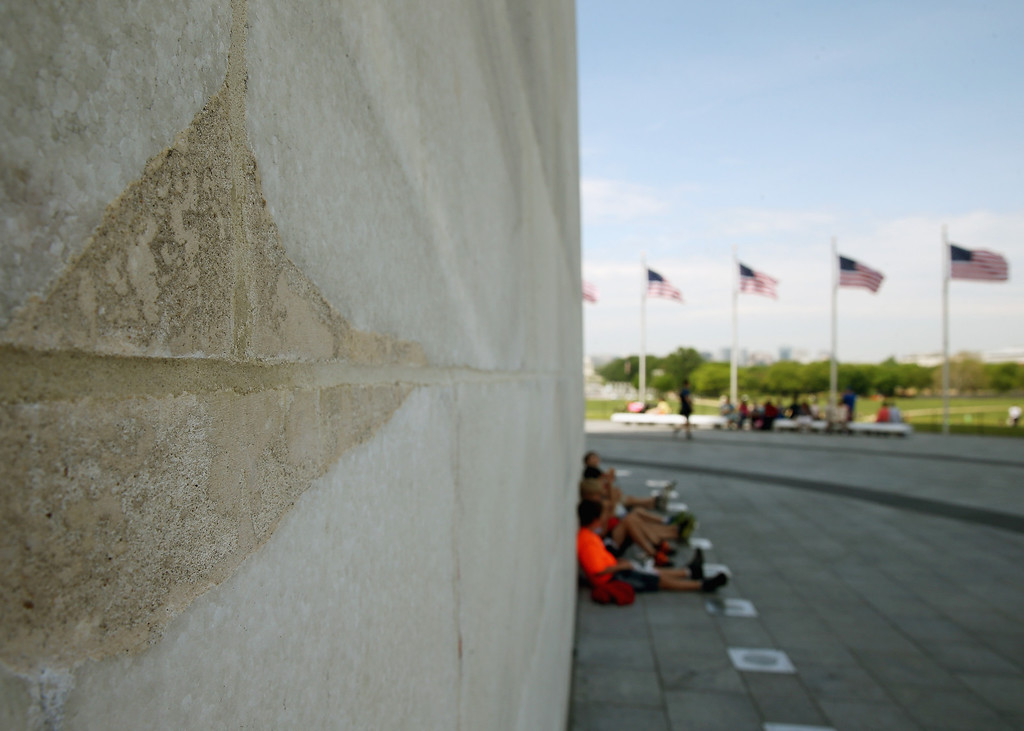 . WASHINGTON, DC - MAY 12:  Recent repairs are visible as children have lunch in the shade of the newly re-opened Washington Monument May 12, 2014 in Washington, DC.   (Photo by Mark Wilson/Getty Images)