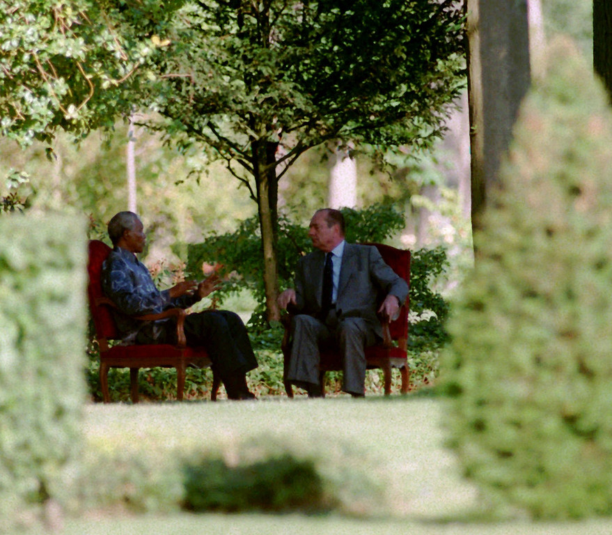 . French President Jacques Chirac, right, listens to his South African counterpart Nelson Mandela in the gardens of the Rambouillet castle, west of Paris Saturday July 13, 1996. Nelson Mandela arrived earlier today for a four-day visiti in France and will stay at the Rambouillet castle.(AP photo/Remy de la Mauviniere)