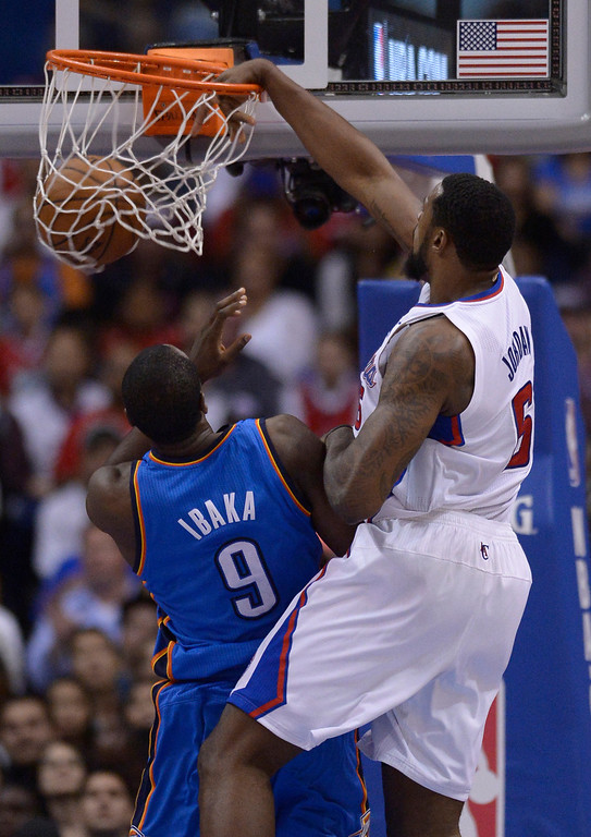 """. Clippers#6 DeAndre Jordan dunks the ball over \""""t9\"""" in the second half. The Oklahoma City Thunder defeated the Clippers 107-101 in a regular season game at Staples Center in Los Angeles, CA. 4/9/2014(Photo by John McCoy / Los Angeles Daily News)"""
