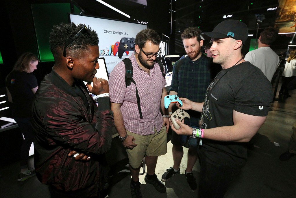 . IMAGE DISTRIBUTED FOR MICROSOFT - Fans customize controllers with Xbox Design Lab at the Xbox Media Showcase at E3 2017 in Los Angeles on Monday, June 12, 2017. (Photo by Casey Rodgers/Invision for Microsoft/AP Images)