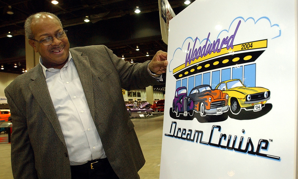 . Pastor Douglas Jones, President, Woodward Dream Cruise, with the 2004 Woodward Dream Cruise logo unveiled at Autorama at Cobo Center in Detroit, Friday February 27, 2004.