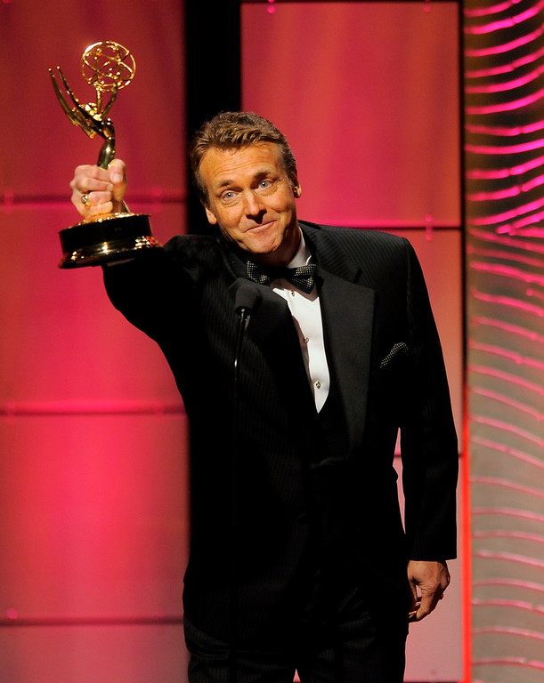 """. Doug Davidson accepts the award for outstanding lead actor in a drama series for \""""The Young and the Restless\"""" at the 40th Annual Daytime Emmy Awards on Sunday, June 16, 2013, in Beverly Hills, Calif. (Photo by Chris Pizzello/Invision/AP)"""