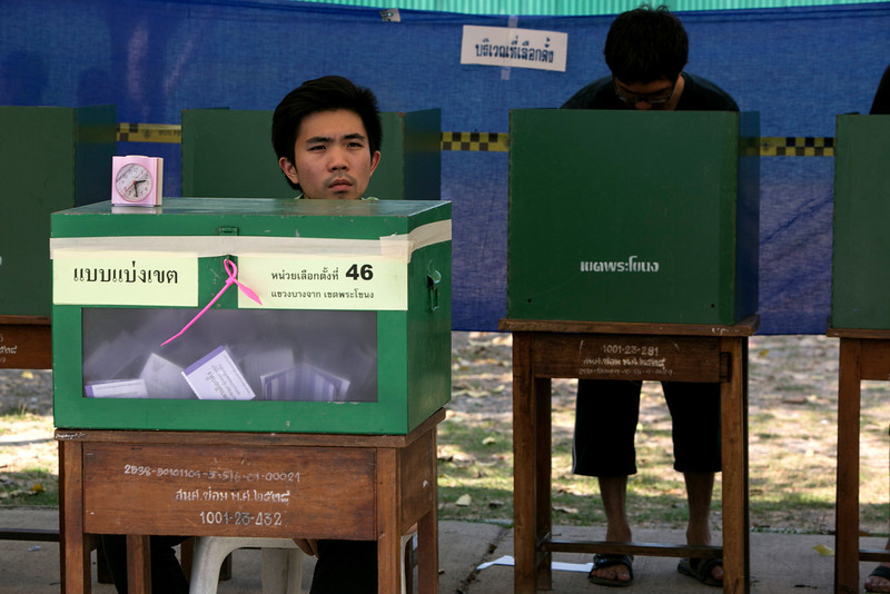 . Thai voters cast their ballots during the general elections on February 2, 2014 in Bangkok, Thailand.  Anti - government protesters took over government buildings where ballot boxes were stored as an attempt to derail the elections. Bangkok Shutdown has been in effect for over two weeks as the anti-government protesters continue to block major intersections. The Thai government imposed a 60-day state of emergency in Bangkok and the surrounding provinces in an attempt to cope with the on-going political turmoil however this decree has had no effect on the mass protests.  (Photo by Paula Bronstein/Getty Images)