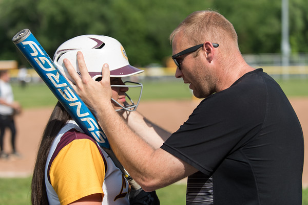 05/30/18 Wesley Bunnell | Staff New Britain softball defeated New Milford 13-10 in a first round CIAC Class LL tournament game on Tuesday afternoon at Martha Hart Park. Makaila Masterson (8) speaks with an assistant coach.
