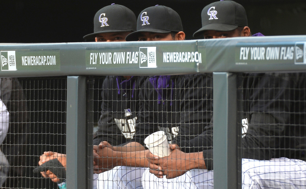 . Colorado Rockies left fielder Carlos Gonzalez (5) Colorado Rockies starting pitcher Jorge De La Rosa (29) and Colorado Rockies starting pitcher Juan Nicasio (12) sit in the dugout during their game against the Arizona Diamondbacks June 4, 2014 at Coors Field. (Photo by John Leyba/The Denver Post)