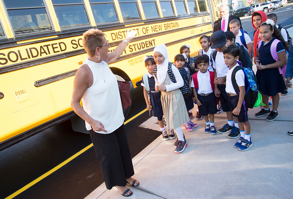 09/03/19 Wesley Bunnell | StaffrrSuperintendent of Schools Nancy Sarra leads the first bus full of students to arrive at Smalley School on the districts first day of school on Tuesday September 3, 2019.