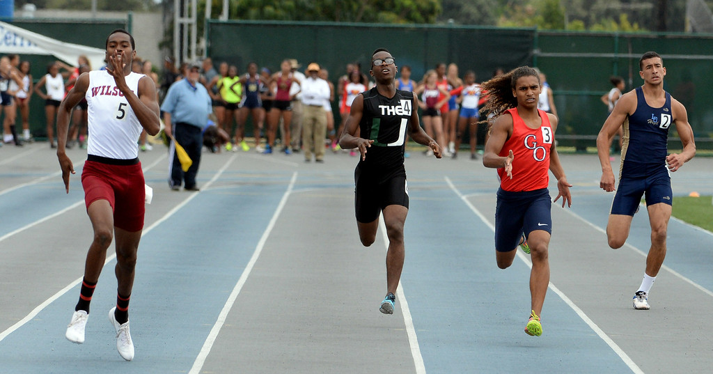 . Wilson\'s Kemonie Briggs, left, along with Upland\'s Antonio Woodard competes in the division 1 400 meters race during the CIF Southern Section track and final Championships at Cerritos College in Norwalk, Calif., Saturday, May 24, 2014.   (Keith Birmingham/Pasadena Star-News)