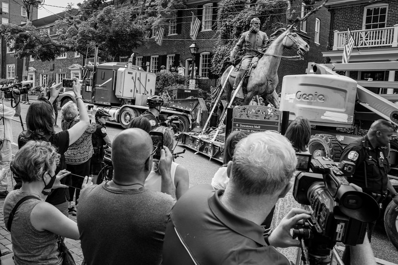 Media and onlookers record Stonewall Jackson statue as it is towed from the park in Charlottesville, Virgina where it stood for almost a century.