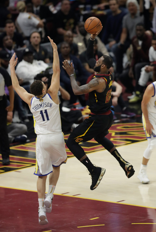 . Cleveland Cavaliers\' LeBron James shoots over Golden State Warriors\' Klay Thompson in the first half of Game 4 of basketball\'s NBA Finals, Friday, June 8, 2018, in Cleveland. (AP Photo/Tony Dejak)