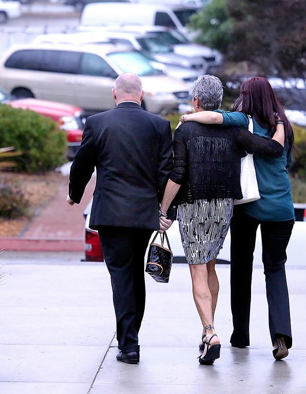 . Alix Tichelman�s parents Bart and Leslie Tichelman and her sister Monica Tichelman leave the Santa Cruz County Courthouse after Wednesday�s arraignment.(Shmuel Thaler -- Santa Cruz Sentinel)
