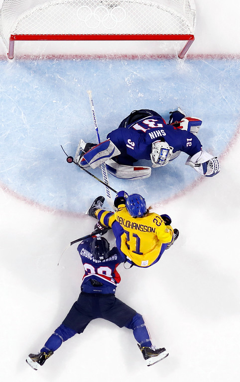 . Johansson Erica Uden (21), of Sweden, scores a goal against South Korea\'s goalie Shin So-jung (31), of the combined Koreas team, during the first period of the preliminary round of the women\'s hockey game at the 2018 Winter Olympics in Gangneung, South Korea, Monday, Feb. 12, 2018. (AP Photo/Julio Cortez)