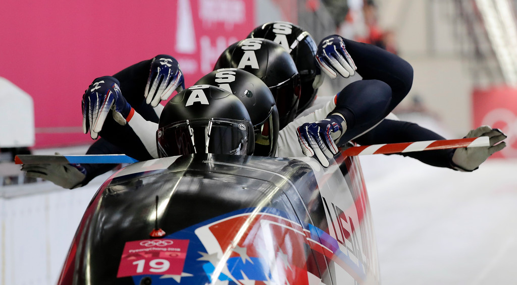 . Driver Justin Olsen, Christopher Fogt, Carlo Valdes and Nathan Weber of the United States start their third heat during the four-man bobsled competition final at the 2018 Winter Olympics in Pyeongchang, South Korea, Sunday, Feb. 25, 2018. (AP Photo/Wong Maye-E)