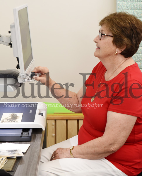 Harold Aughton/Butler Eagle: Ella Maxwell, 81, of Slippery Rock is delighted with Merlin's capabilities at the Slippery Rock Community Library.