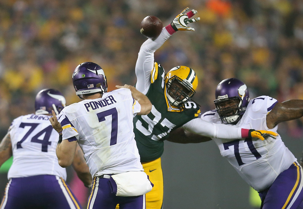 . GREEN BAY, WI - OCTOBER 02: Luther Robinson #97 of the Green Bay Packers blocks the pass by quarterback  Christian Ponder #7 of the Minnesota Vikings in the second quarter of the NFL game at Lambeau Field on October 2, 2014 in Green Bay, Wisconsin. (Photo by Jonathan Daniel/Getty Images)