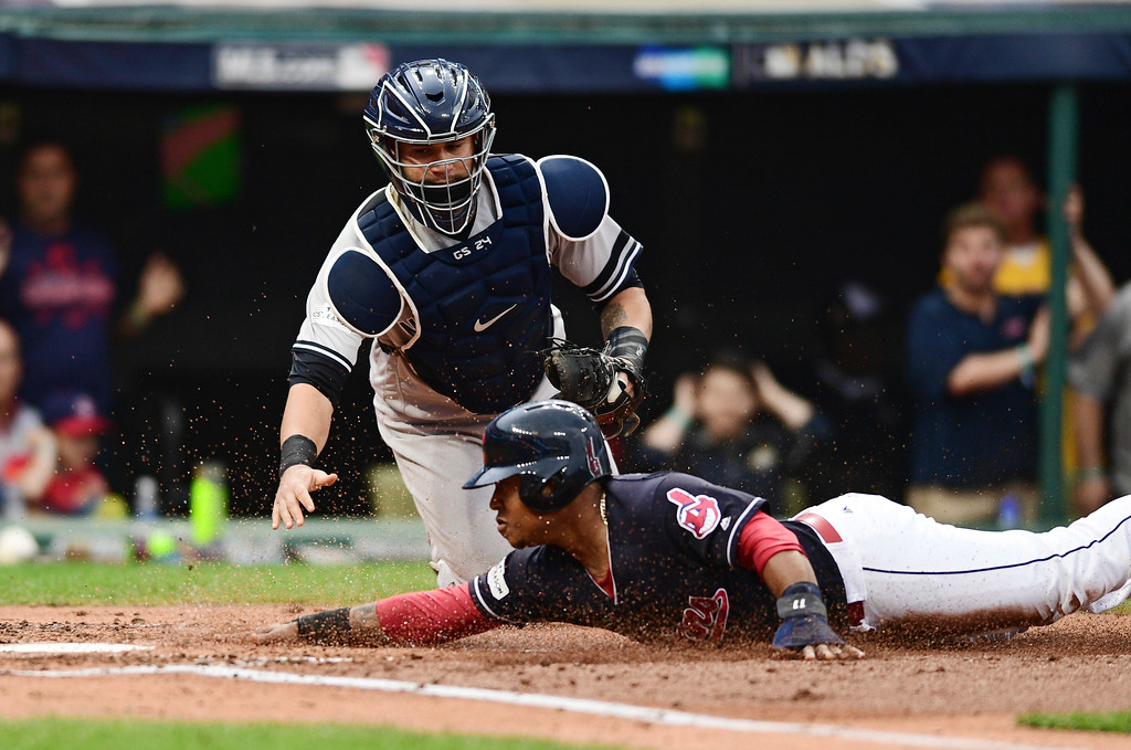 . Cleveland Indians\' Jose Ramirez slides safely into home plate as New York Yankees catcher Gary Sanchez is late on the tag in the second inning of Game 2 of baseball\'s American League Division Series, Friday, Oct. 6, 2017, in Cleveland. Ramirez scored on a two-run single by Carlos Santana. (AP Photo/David Dermer)