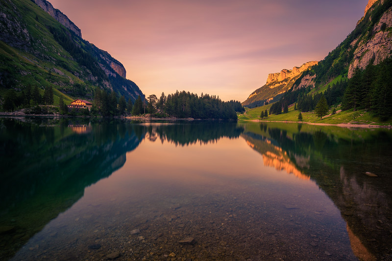 Sunset over the Seealpsee lake in the Swiss Alps, Switzerland