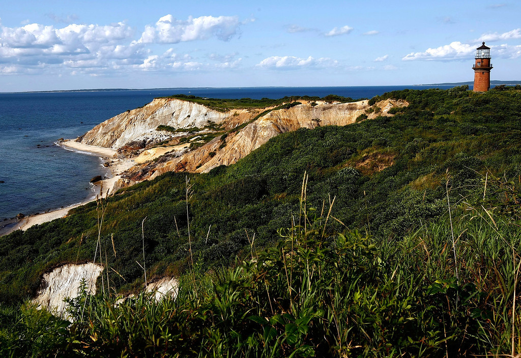 . Massachusetts # 10.  The cliffs and lighthouse at Gay Head are seen August 7, 2009 in Aquinnah, Massachusetts on the island of Martha\'s Vineyard.  (Photo by Win McNamee/Getty Images)