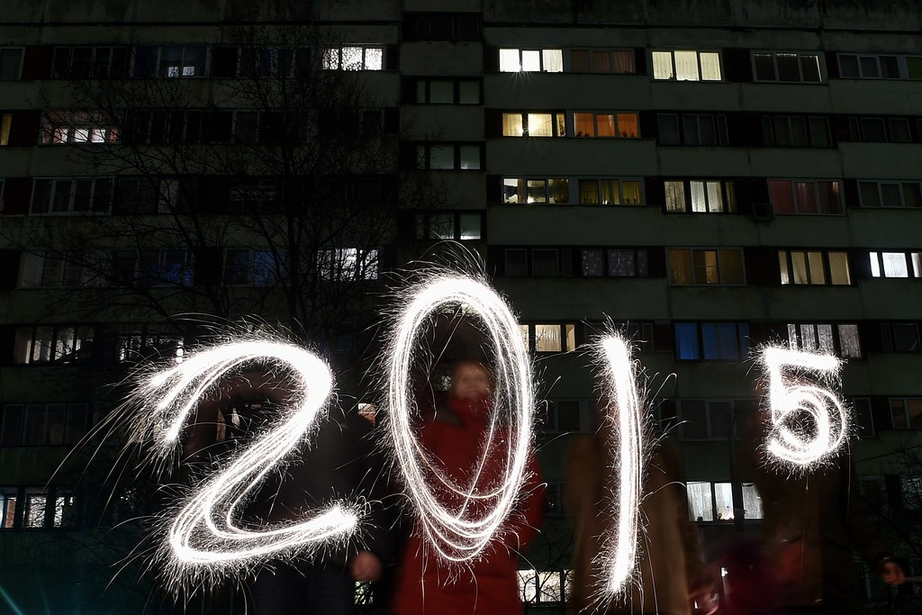 """. People write \""""2015\"""" with sparklers as they celebrate the New Year in the suburb of St Petersburg late on December 31, 2014. New Year\'s is the biggest holiday of the year in Russia, followed by Orthodox Christmas celebrated on January 7. AFP PHOTO/KIRILL KUDRYAVTSEVKIRILL KUDRYAVTSEV/AFP/Getty Images"""