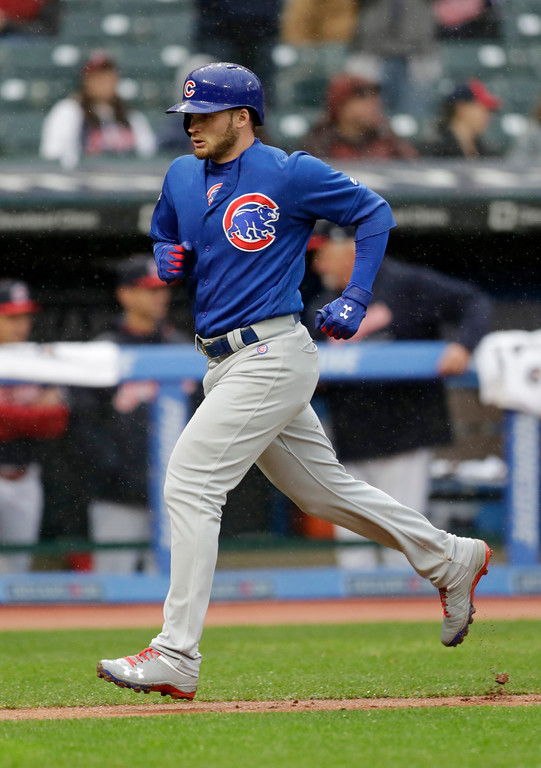 . Chicago Cubs\' Ian Happ runs the bases after hitting a solo home run off Cleveland Indians starting pitcher Josh Tomlin in the fourth inning of a baseball game, Tuesday, April 24, 2018, in Cleveland. (AP Photo/Tony Dejak)