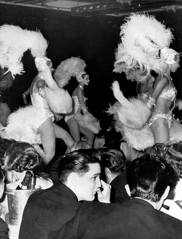 . American rock and roll singer and U.S. Army G.I. Elvis Presley, foreground left, is shown at the Lido Cabaret during his eight-day leave on his first evening in Paris, France, June 16, 1959.  (AP Photo)