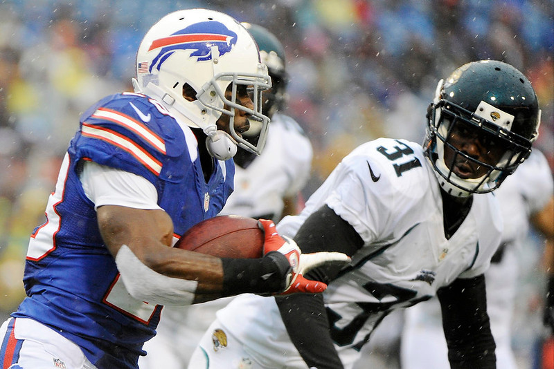 . Buffalo Bills running back C.J. Spiller (28) runs past Jacksonville Jaguars\' Aaron Ross (31) during the first half of an NFL football game Sunday, Dec. 2, 2012 in Orchard Park, N.Y. (AP Photo/Gary Wiepert)