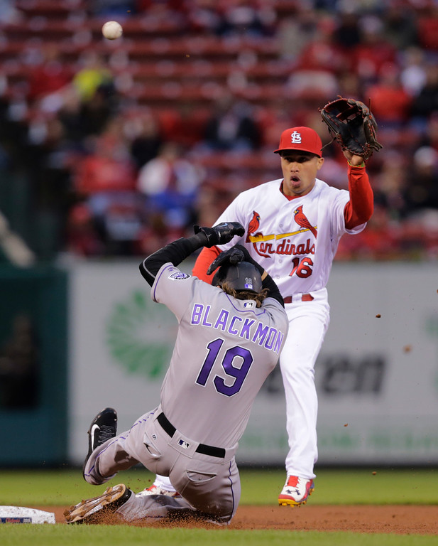 . Colorado Rockies\' Charlie Blackmon (19) steals second as St. Louis Cardinals second baseman Kolten Wong (16) waits for the throw during the third inning of a baseball game, Tuesday, May 17, 2016, in St. Louis. (AP Photo/Tom Gannam)