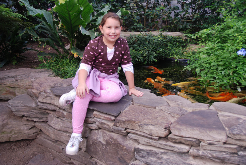 Posing for Aunt Lori by the Koi pond