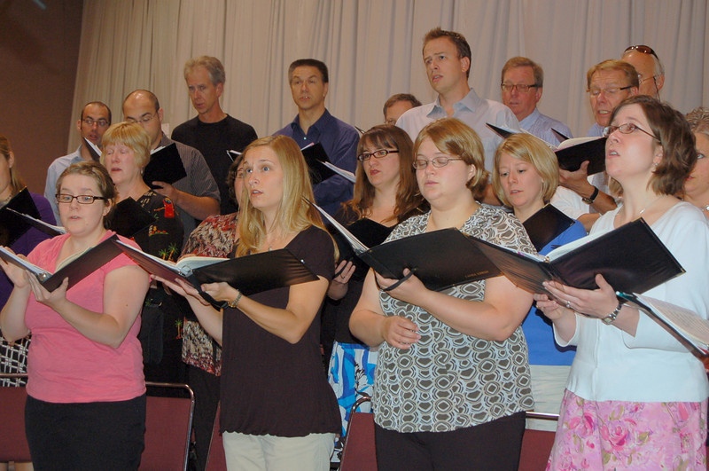 The choir rehearsing for opening worship.