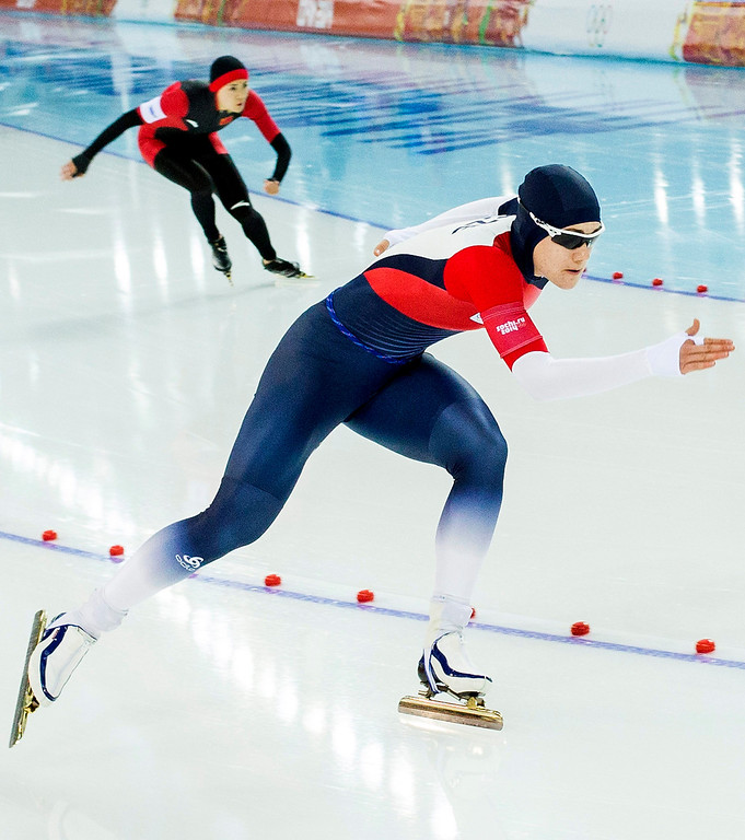 . Karonila Erbanova of Czech Republic  (front) competes Beixing Wang of China during the 1000m Women\'s Speed Skating event in the Adler Arena at the Sochi 2014 Olympic Games, Sochi, Russia, 13 February 2014.  EPA/VINCENT JANNINK