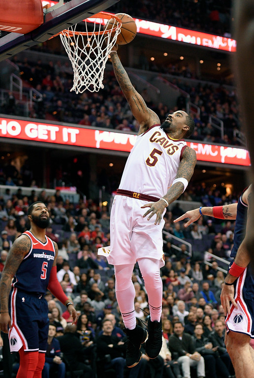 . Cleveland Cavaliers guard JR Smith, right, goes to the basket against Washington Wizards forward Markieff Morris, left, during the first half of an NBA basketball game, Sunday, Dec. 17, 2017, in Washington. (AP Photo/Nick Wass)