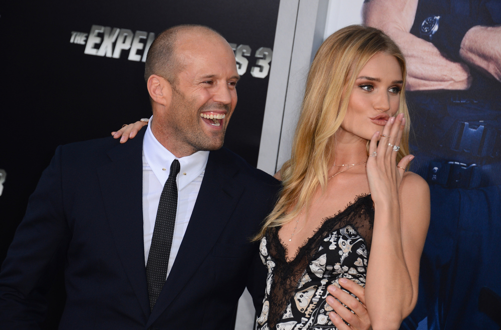""". Jason Statham, left, and Rosie Huntington-Whiteley arrive at the premiere of \""""The Expendables 3\"""" at TCL Chinese Theatre on Monday, Aug. 11, 2014, in Los Angeles. (Photo by Jordan Strauss/Invision/AP)"""