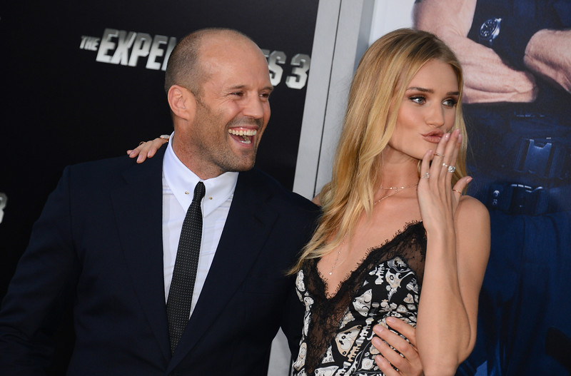 ". Jason Statham, left, and Rosie Huntington-Whiteley arrive at the premiere of ""The Expendables 3\"" at TCL Chinese Theatre on Monday, Aug. 11, 2014, in Los Angeles. (Photo by Jordan Strauss/Invision/AP)"