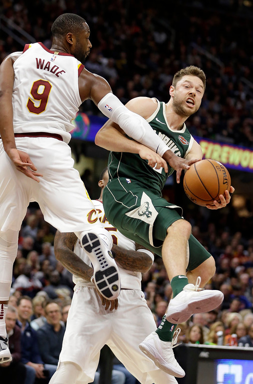 . Milwaukee Bucks\' Matthew Dellavedova (8), from Australia, drives to the basket against Cleveland Cavaliers\' Dwyane Wade (9) in the second half of an NBA basketball game, Tuesday, Nov. 7, 2017, in Cleveland. The Cavaliers won 124-119. (AP Photo/Tony Dejak)