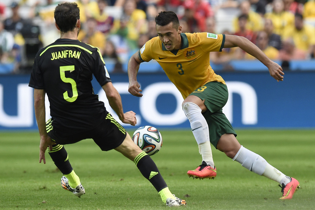 . Australia\'s defender Jason Davidson (R) in action against Spain\'s defender Juanfran during a Group B match between Australia and Spain at the Baixada Arena in Curitiba during the 2014 FIFA World Cup on June 23, 2014.  AFP PHOTO / JUAN BARRETO/AFP/Getty Images