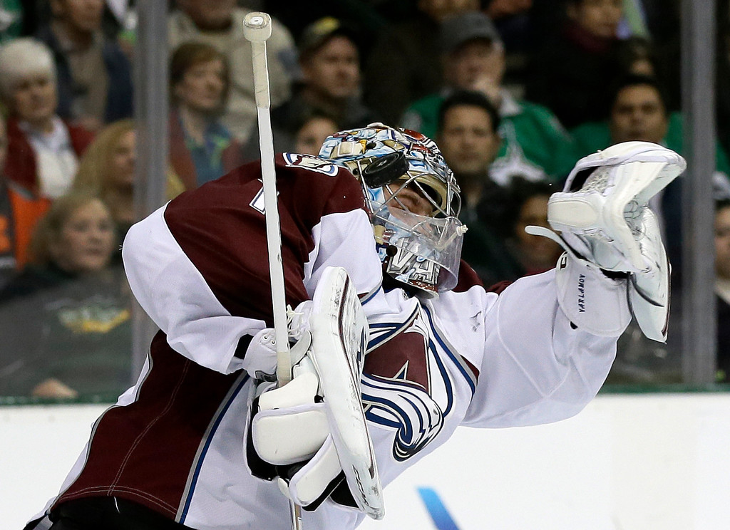 . Colorado Avalanche goalie Semyon Varlamov (1), of Russia, stops a shot from the Dallas Stars in the first period of an NHL hockey game, Monday, Jan. 27, 2014, in Dallas. (AP Photo/Tony Gutierrez)