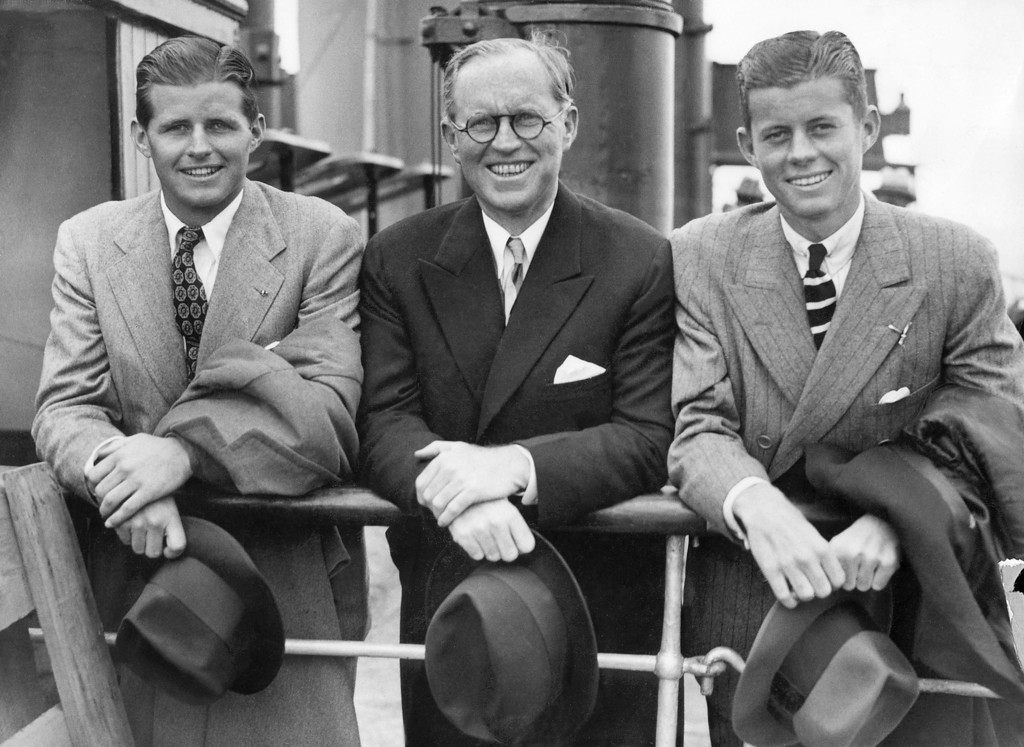 ". Kennedy with brother Joe Jr., left, and father, Joseph, on July 5, 1938, in Southampton on the deck of the French ""Normandy\"" cruise liner after their arrival from the U.S. AFP/Getty Images"