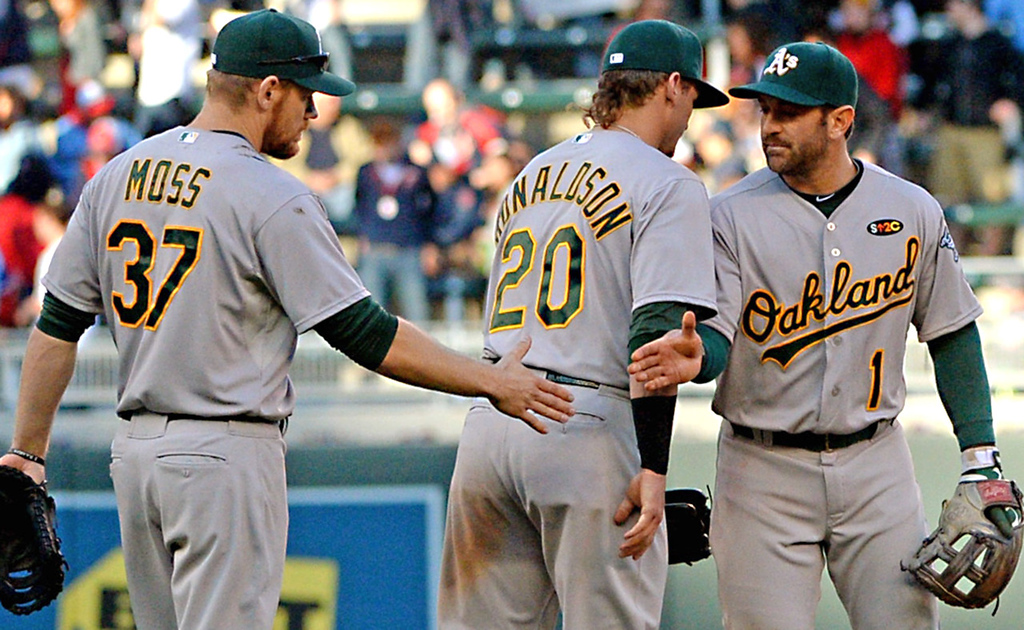 . Oakland\'s Nick Punto, right, congratulates Oakland teammates Josh Donaldson, center and Brandon Moss, left, after the A\'s beat the Twins, 8-3. (Pioneer Press: John Autey)