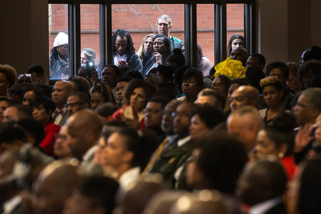 . People watch the Rev. Martin Luther King Jr. holiday commemorative service at Ebenezer Baptist Church through a window, Monday, Jan. 16, 2017, in Atlanta. Martin Luther King Jr.\'s daughter the Rev. Bernice King urged Americans during the service to honor her father\'s legacy regardless of who occupies the Oval Office. (AP Photo/Branden Camp)