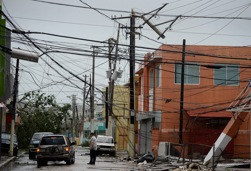 . Power lines are down after the impact of Hurricane Maria, which hit the eastern region of the island in Humacao, Puerto Rico, Wednesday, Sept. 20, 2017. (AP Photo/Carlos Giusti)