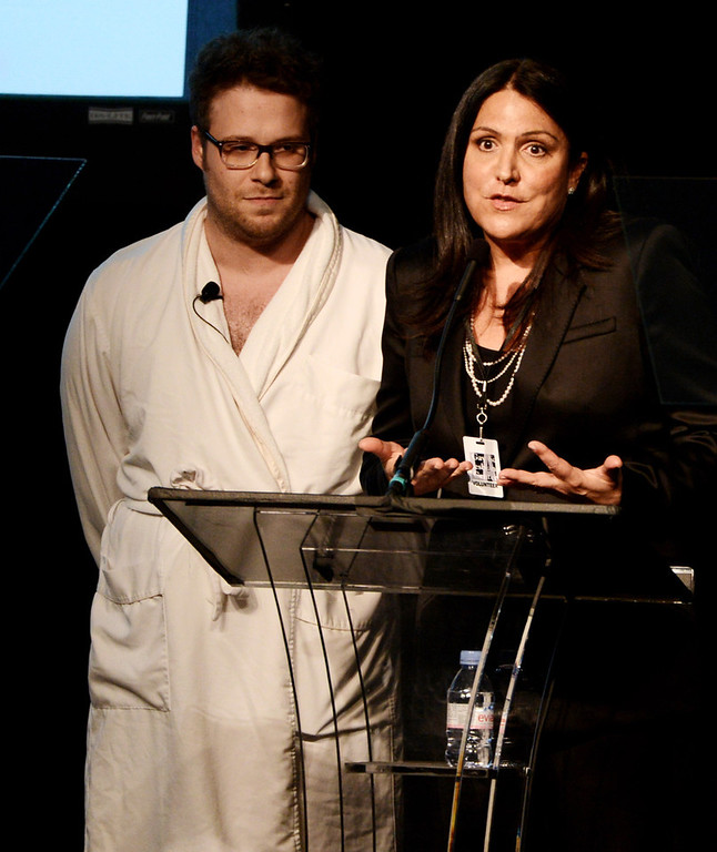""". Actor Seth Rogan (L) and writer/event co-chair Kathy Kloves speak at \""""An Evening\"""" benifiting The Gay & Lesbian Center at the Beverly Wilshire Hotel on March 21, 2013 in Beverly Hills, California.  (Photo by Kevin Winter/Getty Images)"""