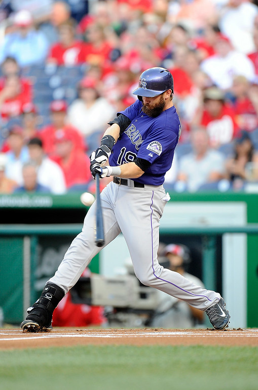 . WASHINGTON, DC - JUNE 30:  Charlie Blackmon #19 of the Colorado Rockies hits a single in the first inning against the Washington Nationals at Nationals Park on June 30, 2014 in Washington, DC.  (Photo by Greg Fiume/Getty Images)